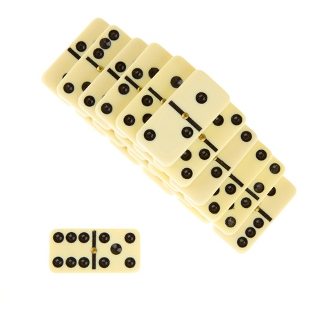 Stacks of dominoes on isolated white background photo
