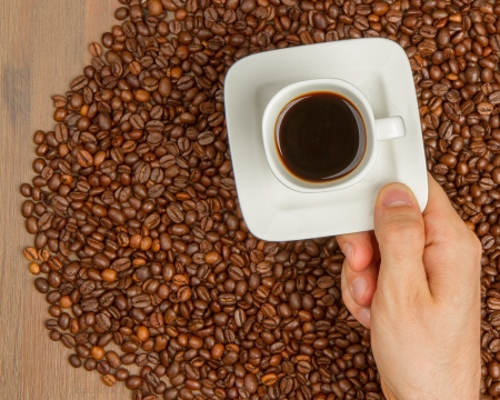 Cup of coffee on aromatic coffee beans. top view photo
