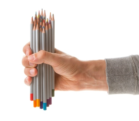 Man holding several color pencils in his hand photo