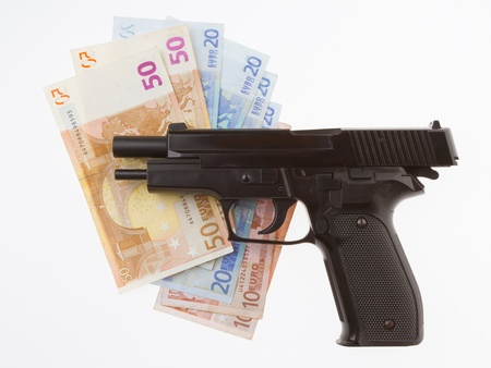 Semi-automatic gun and money isolated on white background photo
