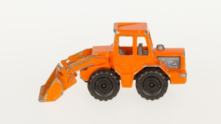 Very old car toy, 1970, orange bulldozer Stock Photo - 14429890