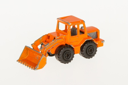 Very old car toy, 1970, orange bulldozer Stock Photo - 14429370
