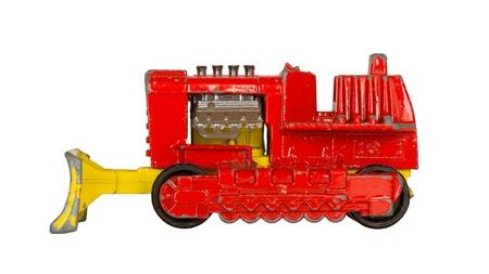 Old toy car (bulldozer, 1970) isolated on white photo