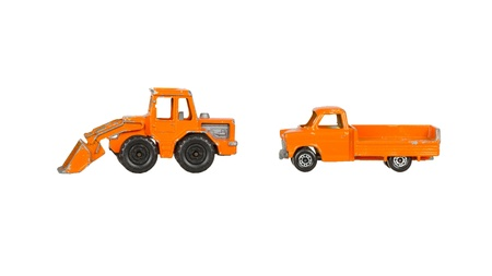 Two old toy cars isolated on a white background Stock Photo - 14429119