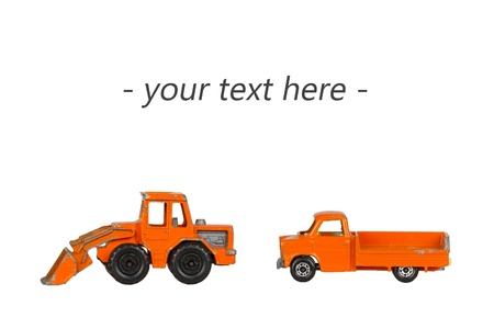Two old toy cars with room for text isolated on a white background photo