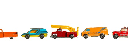 Row of old toy cars (1970) isolated on white photo