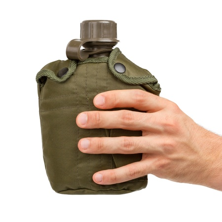 Man holding army water canteen isolated on a white background photo