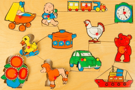Very old wooden puzzle (1970) for children learning illustrations Stock Illustration - 14430461