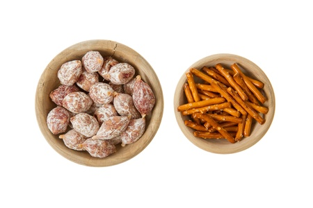 Italian salami and typical dutch salty snacks in wooden bowl, isolated on white Stock Photo - 14430151