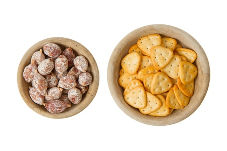 Italian salami and typical dutch salty snacks in wooden bowl, isolated on white Stock Photo - 14430310
