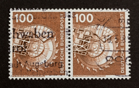 bundespost: GERMANY - CIRCA 1980: Stamp printed in Germany shows a large industrial digger (coal), circa 1980 Stock Photo