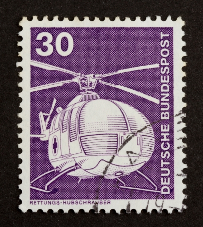 GERMANY - CIRCA 1980: Stamp printed in Germany shows an helicopter, circa 1980 photo