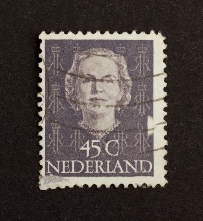 HOLLAND - CIRCA 1970: Stamp printed in the Netherlands shows the head of state, circa 1970 photo
