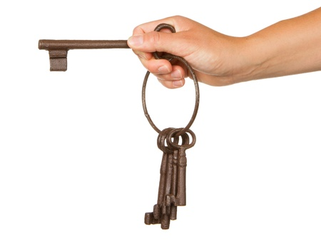 Old rusty bunch of keys in hand, isolated on white Stock Photo - 14431245