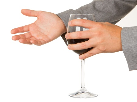 Business woman holding a glass of red wine, isolated on white Stock Photo - 14483477
