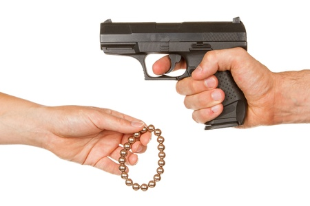 Man with gun threatening a woman to give her jewelry photo