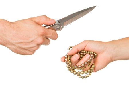 Man with knife threatening a woman to give her jewelry photo