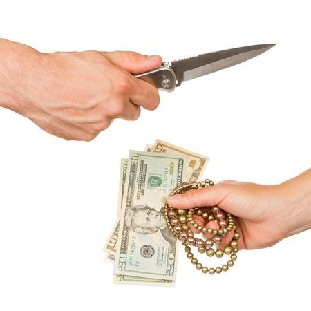 Man with knife threatening a woman to give her jewelry and money photo
