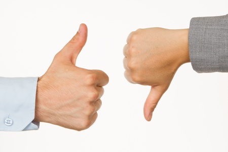 Caucasian business man and woman holding thumb up against white background photo