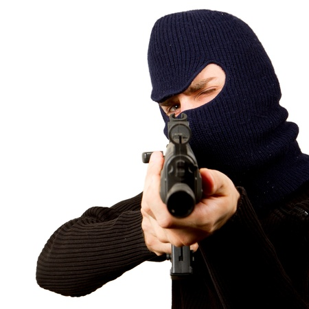 Photo of terrorist with gun attacking someone while pointing it forwards Stock Photo - 14483941