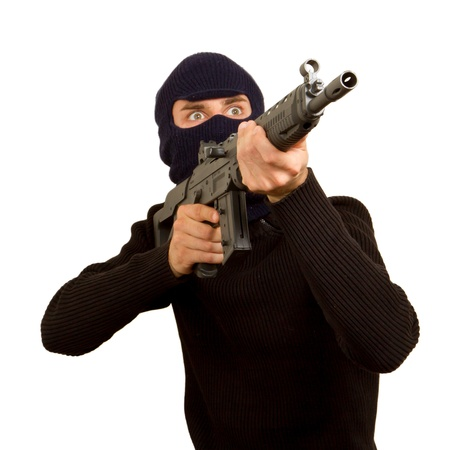 Photo of terrorist with gun attacking someone while pointing it forwards Stock Photo - 14484034