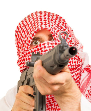 Arab adult with a machine gun, terrorist, isolated on white photo