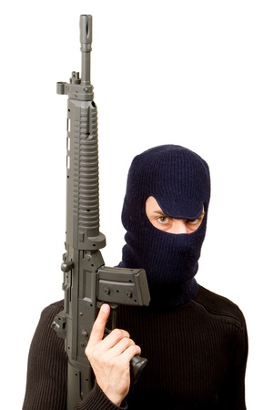 Photo of terrorist with gun attacking someone while pointing it forwards Stock Photo - 14524881