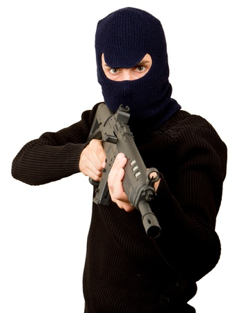 Photo of terrorist with gun attacking someone while pointing it forwards Stock Photo - 14524866
