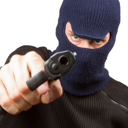 Photo of terrorist with gun attacking someone while pointing it forwards Stock Photo - 14524880