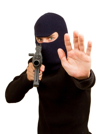 Photo of terrorist with gun attacking someone while pointing it forwards Stock Photo - 14524799