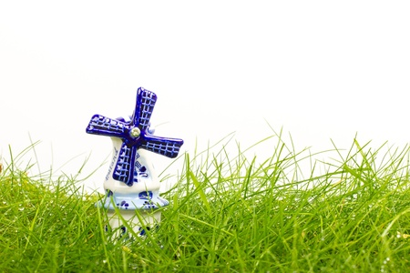 Dutch mini porcelain windmill on wet grass Stock Photo - 14524894