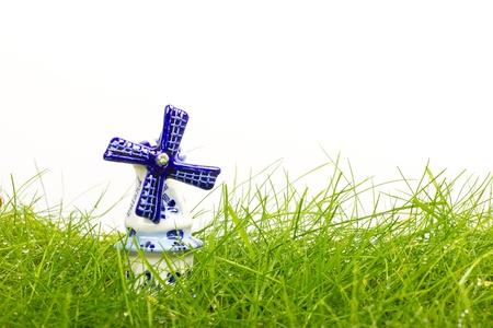 Dutch mini porcelain windmill on wet grass Stock Photo - 14524894