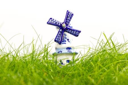Dutch mini porcelain windmill on wet grass Stock Photo - 14524885