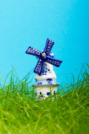 Dutch mini porcelain windmill on wet grass Stock Photo - 14524905