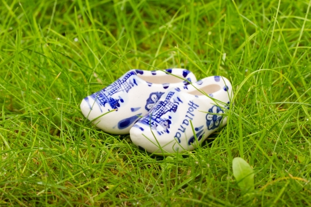 Pair of small porcelain clogs from Holland, isolated in grass Stock Photo - 14524895