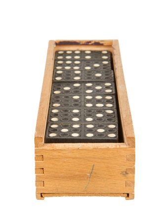 Very old domino in wooden box against the white background photo