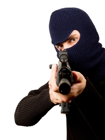 Photo of terrorist with gun attacking someone while pointing it forwards Stock Photo - 14524942