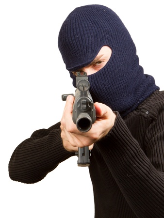 Photo of terrorist with gun attacking someone while pointing it forwards Stock Photo - 14524951