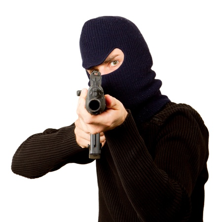 Photo of terrorist with gun attacking someone while pointing it forwards Stock Photo - 14524931