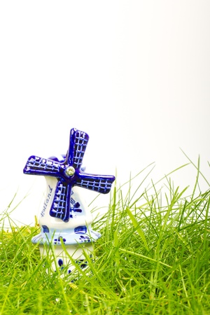 Dutch mini porcelain windmill on wet grass photo