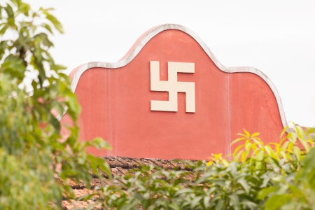 Swastika symbol on top of a temple in Vietnam (Nha Trang) photo