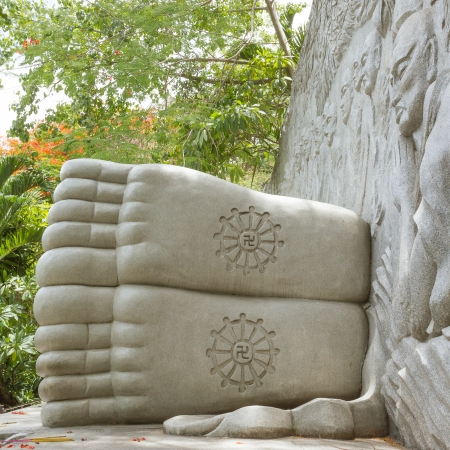 Feet of a sleeping buddha, decorated with a swastika, landmark on Nha Trang, Vietnam