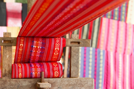 Handmade silk textile industry, silk scarf on a old machine (Vietnam) photo