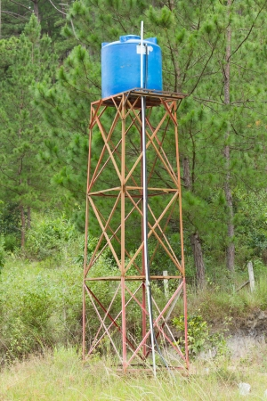 country store: Primitive blue water tower in central Vietnam