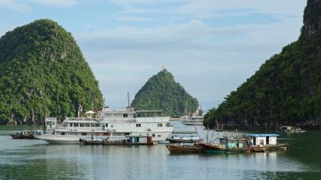 HA LONG BAY, VIETNAM AUG 10, 2012. Tourist Boats in Ha Long Bay. Ha Long Bay is one of the seven world wonders. Vietnam, August 10, 2012