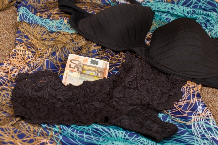 Euros and black underwear with dress isolated Stock Photo - 15247173