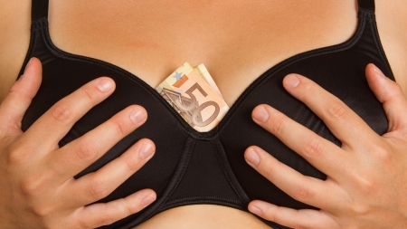 Concept - woman with cash in a bra (50 euro) Stock Photo - 15247208