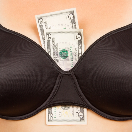 Concept - woman with cash in a bra (10 dollar) Stock Photo - 15247206