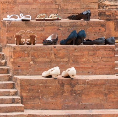 journeying: Shoes at the old entrance of a mosque Stock Photo
