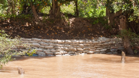 sandbag: Dike made from sandbags erected to prevent the Mekong Delta from flooding one of the islands